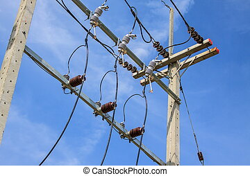 Electric pole with wires on a background of blue sky