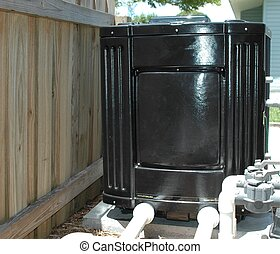 Electric pool heater photographed from our backyard pool
