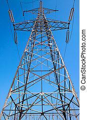 Electric power pole against blue sky