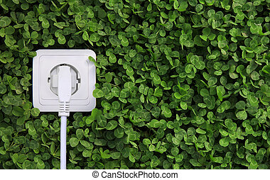 electric power receptacle on a green grass background -...