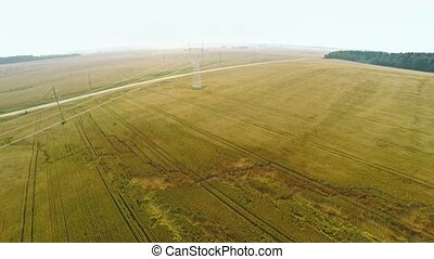 Electric power station with power lines near fields with...