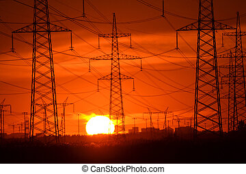 Electric power transmission lines at sunset - The photo of ...
