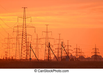 Electric power transmission lines at sunset