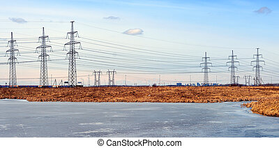 Electric power transmission lines on coast of lake.