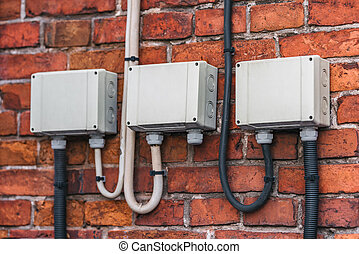 Electric shields on the brick wall