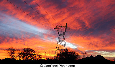 Silhouetted power lines in the southwest desert