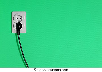 Electric outlet on a green wall