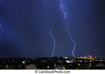 Electric Storm Above the City. Night Stormy Sky. Severe...