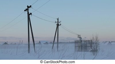 electric substation transformer box in the winter foggy field