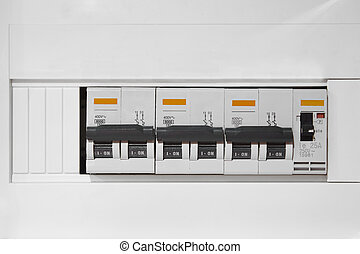 Electric switchboard control over a white wall. Electrical devices