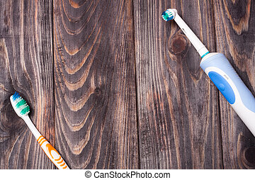 Electric Toothbrush on a black wooden background
