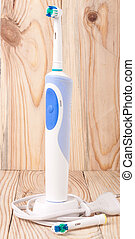 Electric Toothbrush on a light wooden background