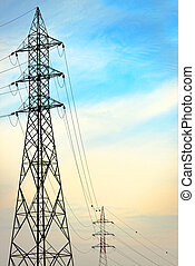 Electric tower against blue sky