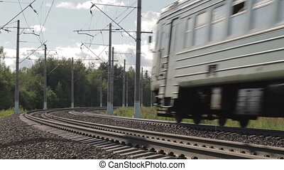 Electric train from the viewer. - Electric train is passing...