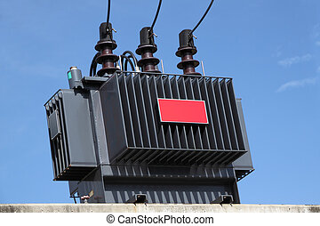 Electric transformer on some power concrete pole.