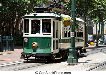 Electric Trolley Car - Passengers ride an electric trolley...