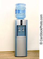 Electric water cooler against the background walls of the...