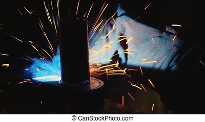 Electric welder at work. Lots of hot sparks