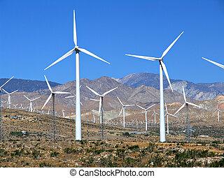 electric wind turbine field - a field of wind turbines near...