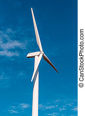 Electric wind turbine with clear blue sky