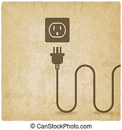 electric wire with plug near outlet old background