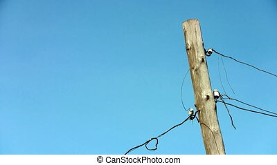 Electric wooden pole against the sky
