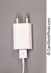 Electrical adapter to USB port on gray background