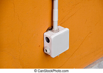 electrical box for splicing out door, on yellow wall