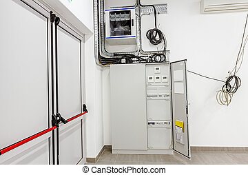 Electrical cabinet with automatic fuse switches and modern...
