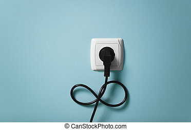 Electrical cable into the socket in infinity symbol.