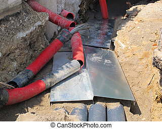 electrical cables and optical fibres in the excavation in a ...