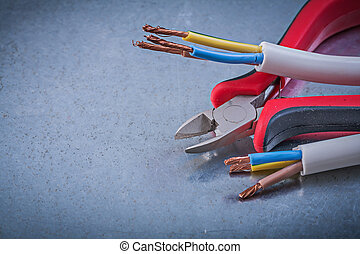 Electrical cables wires nippers on scratched metallic ...
