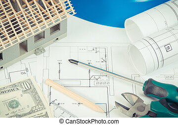Electrical construction drawings, work tools and accessories, small house and currencies dollar