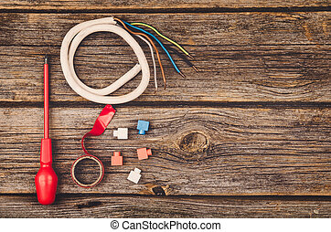 Electrical construction equipment and tools on wooden table top view