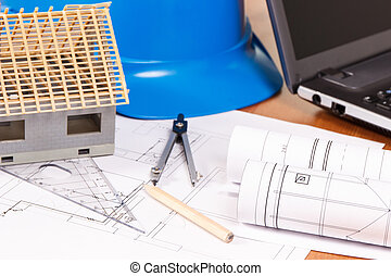 Electrical diagrams, accessories for engineer jobs and small house on desk, building home concept