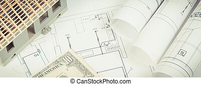 Electrical diagrams, house under construction and currencies dollar, building home cost concept