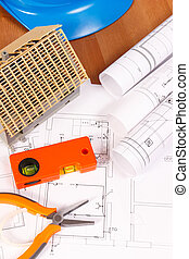 Electrical diagrams, orange work tools, blue helmet for engineer jobs and house under construction, building home concept