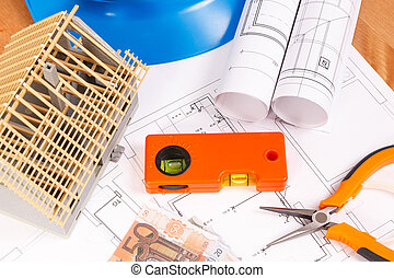Electrical diagrams, work tools for engineer jobs, house under construction and currencies euro on desk in office