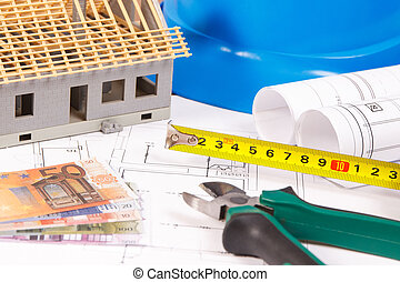 Electrical diagrams, work tools for engineer jobs, toy house under construction and currencies euro, building home cost concept