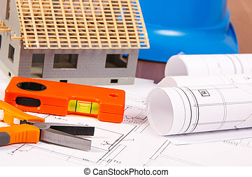 Electrical diagrams, work tools, helmet for engineer jobs and house under construction, building home concept