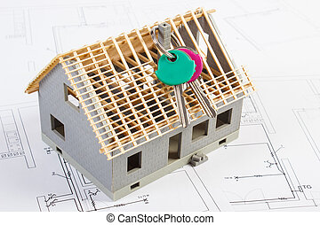 Electrical drawings, diagrams and house under construction with home keys, building home concept