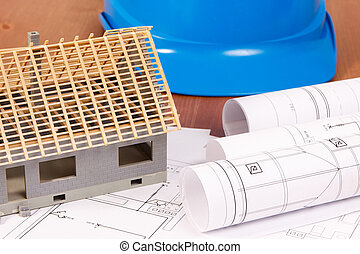 Electrical drawings for engineer jobs, house under construction and protective helmet, building home concept