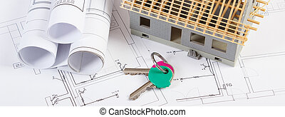 Electrical drawings, home keys and small house under construction, concept of building home