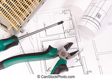 Electrical drawings, work tools and house under construction, building home concept