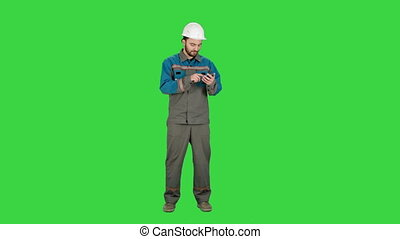 Electrical Engineer send a message with cell phone on a Green Screen, Chroma Key.