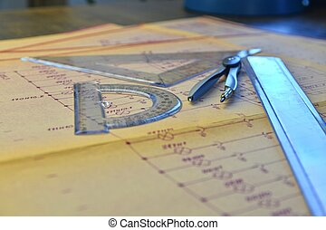 Electrical engineer workplace - electrotechnical project, rulers, and divider compass. Construction and electrotechnology concept. Engineering tools. Circuit diagram.