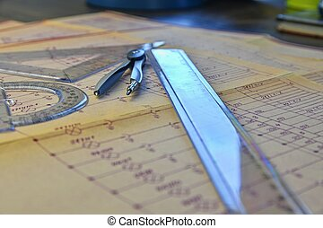 Electrical engineer workplace - electrotechnical project, rulers, and divider compass. Construction and electrotechnology concept. Engineering tools. Circuit diagram on background.