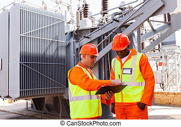 electrical engineers discussing work in power plant