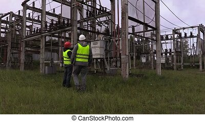 Electrical engineers take inspection the technical condition...