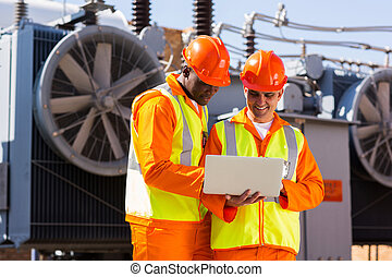 electrical engineers using laptop computer